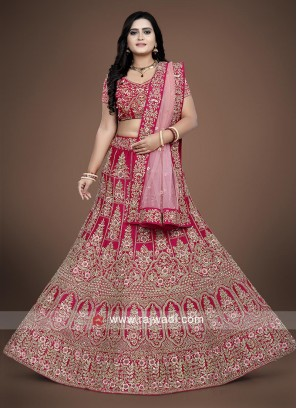 Crimson color Lehenga choli with peach dupatta.