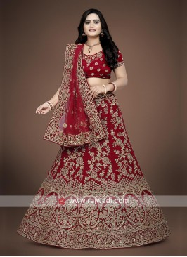 Red Lehenga choli with matching dupatta.