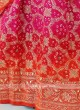 Rani And Orange Bandhani Silk Saree