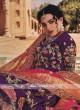 Dark purple lehenga choli with pink dupatta