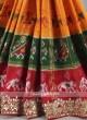 Orange, Red and green color pure silk saree