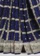 Dark blue chiffion saree with matching blouse.