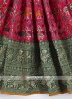 Rani and green color satin silk saree