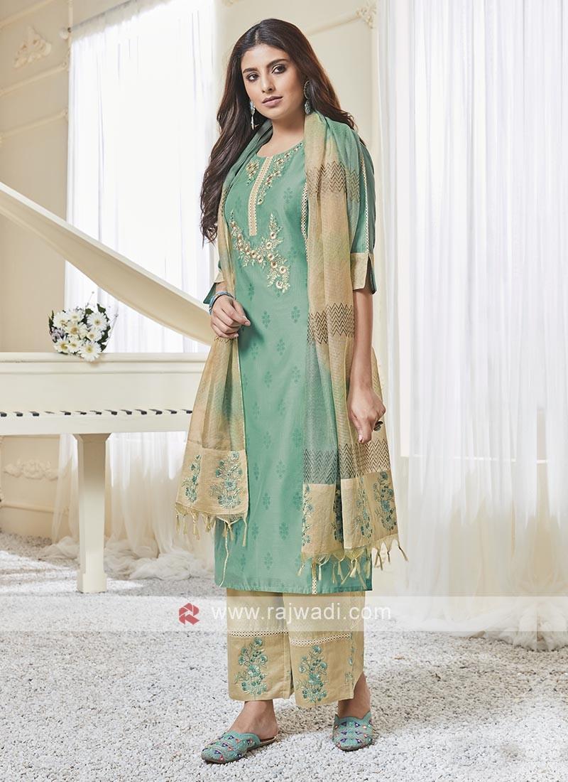 Shagufta Aquamarine And Cream Color Palazzo Salwar Suit