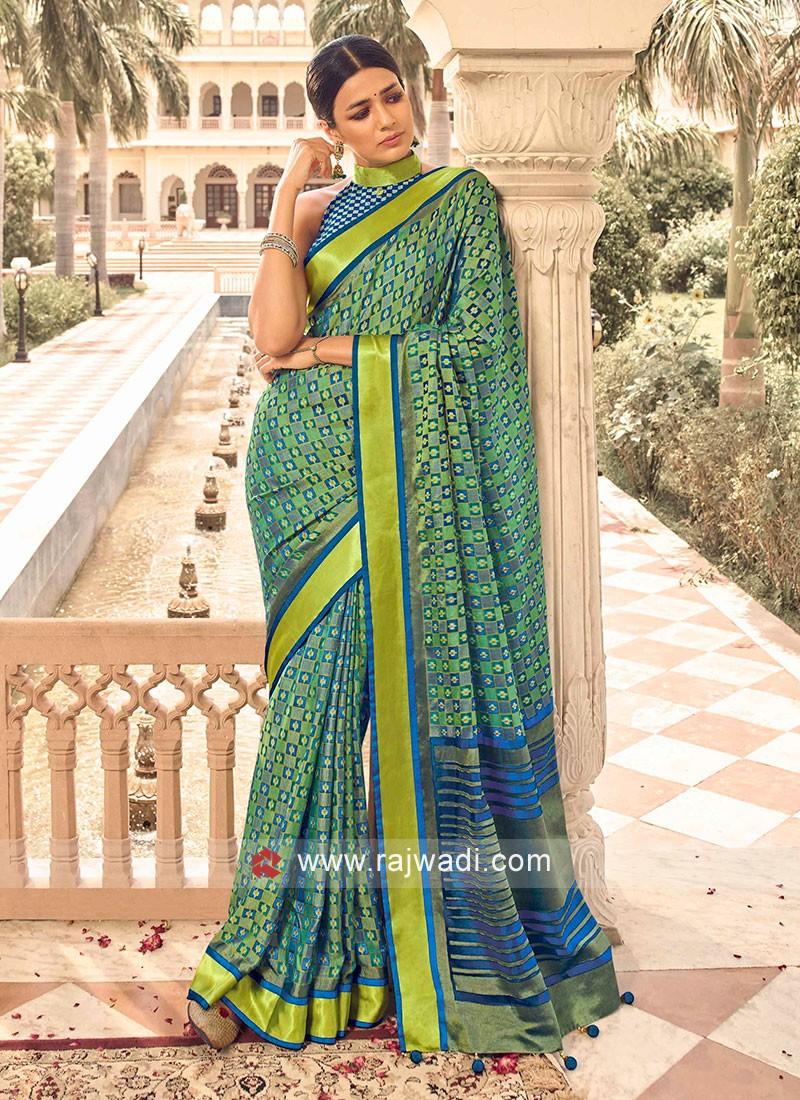 Art Dola Silk Pista Green And Blue Combination Saree