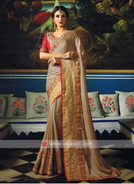 Art Silk Embellished Sari with Blouse Piece