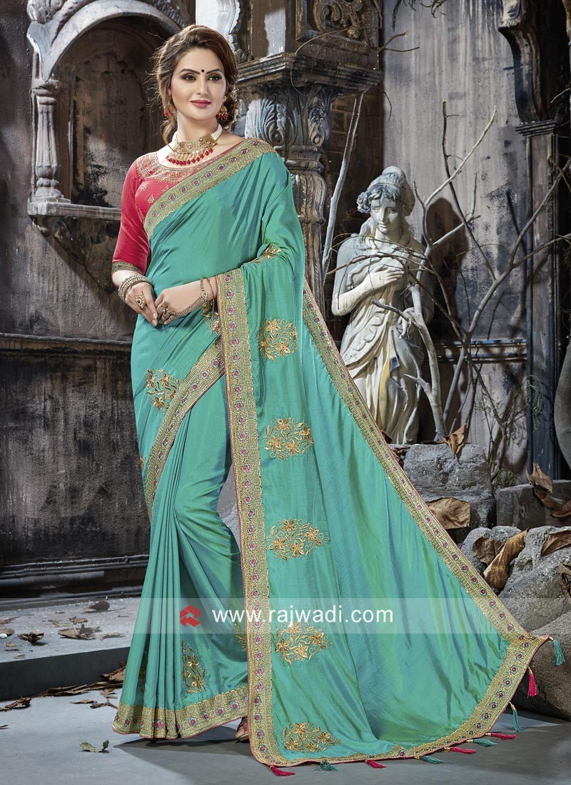 Art Silk Embroidered Saree with Raw Silk Blouse