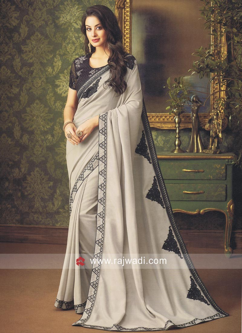 09734a0253972c Art Silk Saree with Black Blouse. Hover to zoom