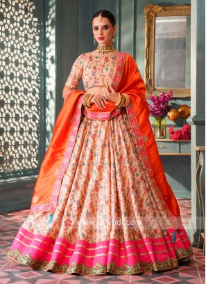 Attractive Cream & Orange Lehenga Choli