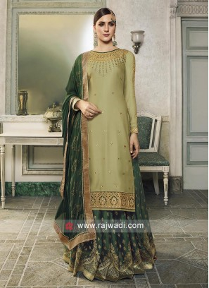 Pista Green and green Banarasi Silk salwar kameez.