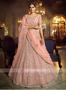 Attractive Peach Color Net Lehenga Choli