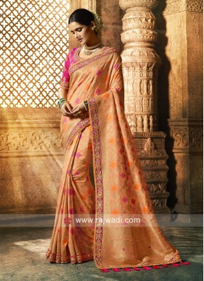 Attractive Peach Saree with Raw Silk Blouse