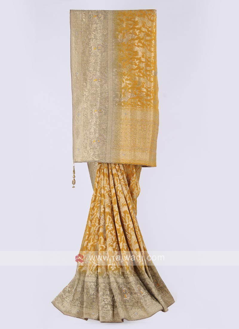 Banarasi silk saree in golden yellow color
