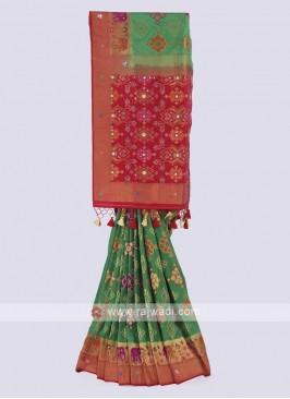 Banarasi silk saree in green and red color