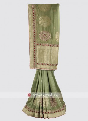 Banarasi silk saree in mehandi green color