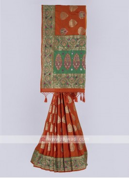 Banarasi Silk saree in orange and green color