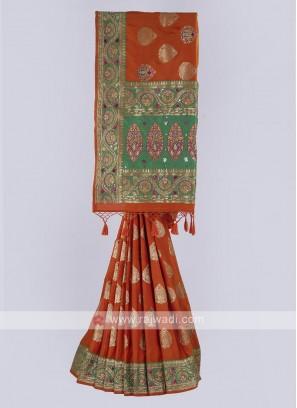 Banarasi Silk saree in orange and green color