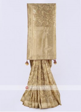 Banarasi tissue saree in golden color