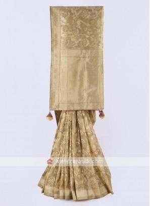 Banarasi tissue saree in golden color