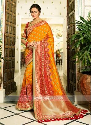 Banasari Mustard yellow  saree with  heavy zari woven blouse piece.