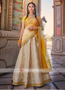 Beige And Mustard Lehenga Choli