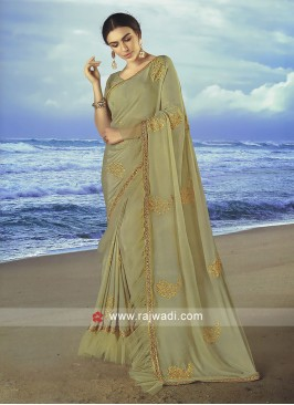 Beige chiffon saree with matching blouse.