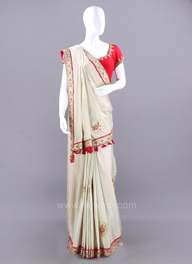 Beige Chiffon Silk Sari with Red Tassels