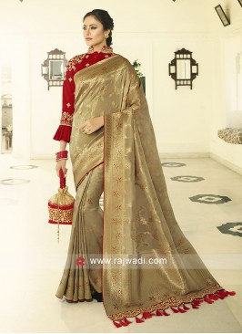 Beige color banasari silk saree looking amazing with contrast blouse piece
