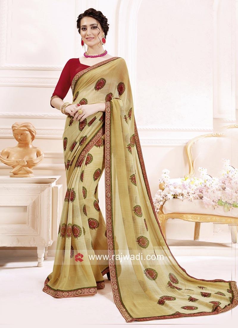 Beige Printed Sari with Maroon Blouse