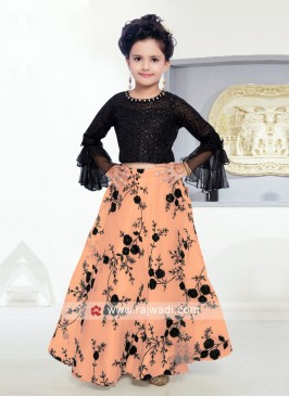 Black and peach choli suit