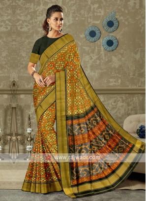 Black and rust color pure silk saree