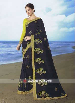 Black Art silk saree with mehandi green blouse.