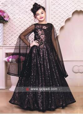 Black color floor length gown.