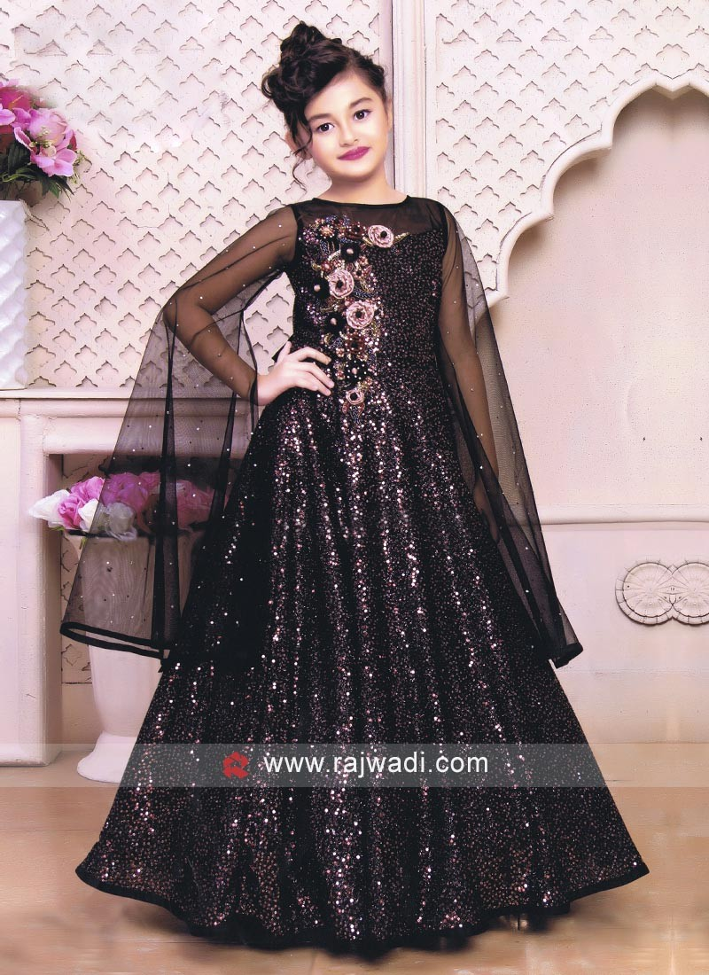 Black color floor length gown.