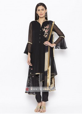 black kurta and pant style suit