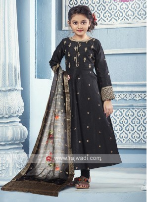 Black silk Anarkali with matching Salwar and dupatta.