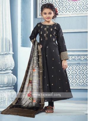 Black silk Anarkali with matching Salwar and dupatta.