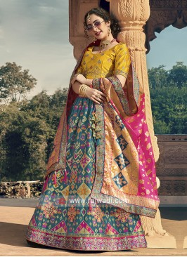 Blue and yellow lehenga choli with pink dupatta