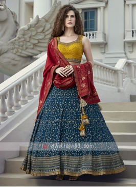 blue and yellow silk choli suit
