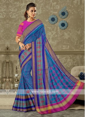 Blue saree with contrast pink color blouse