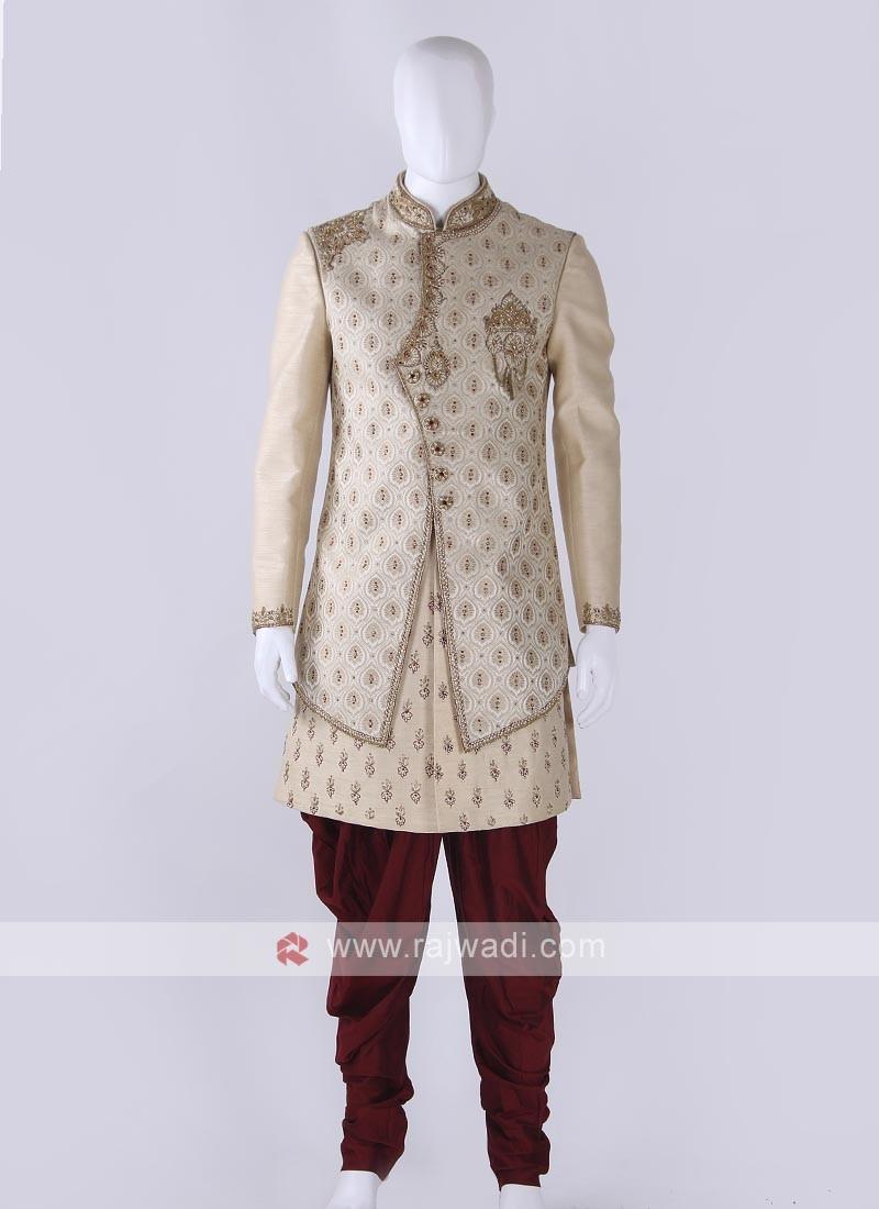 Brocade silk sherwani in golden cream color