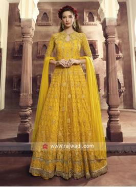 Butterfly Net Heavy Salwar Kameez in Yellow