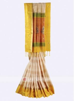 Cream and yellow color silk saree
