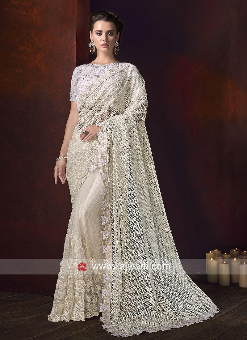Cream Net Saree with White Raw Silk Blouse