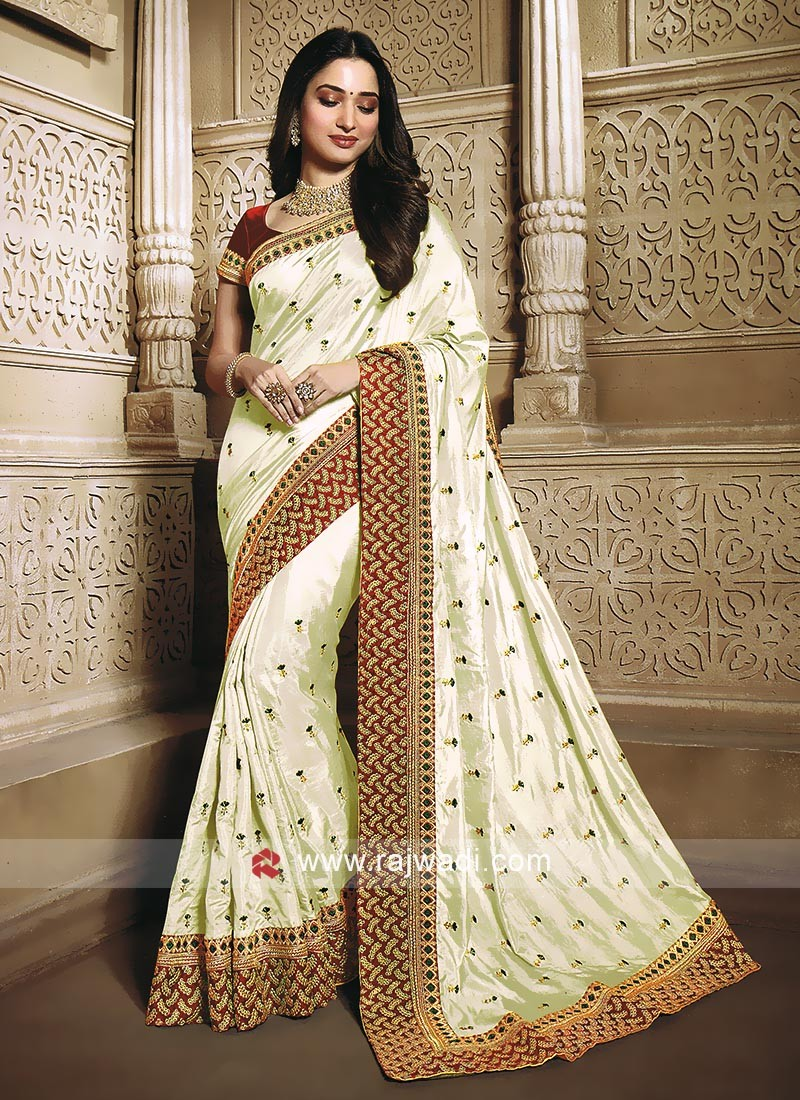 Cream color saree with maroon blouse