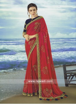 Crimson Art Silk saree with contrast blouse.