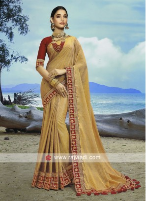 Dark Beige Art Silk saree with maroon blouse.
