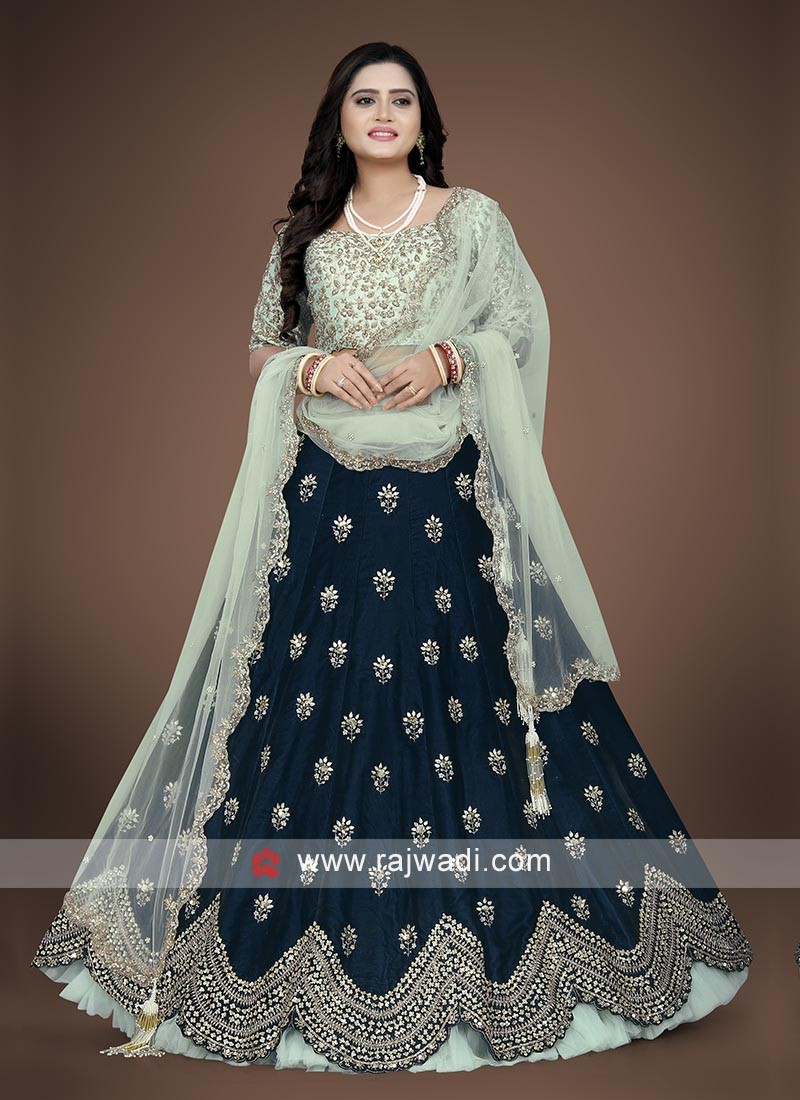 Dark blue and pista green choli suit
