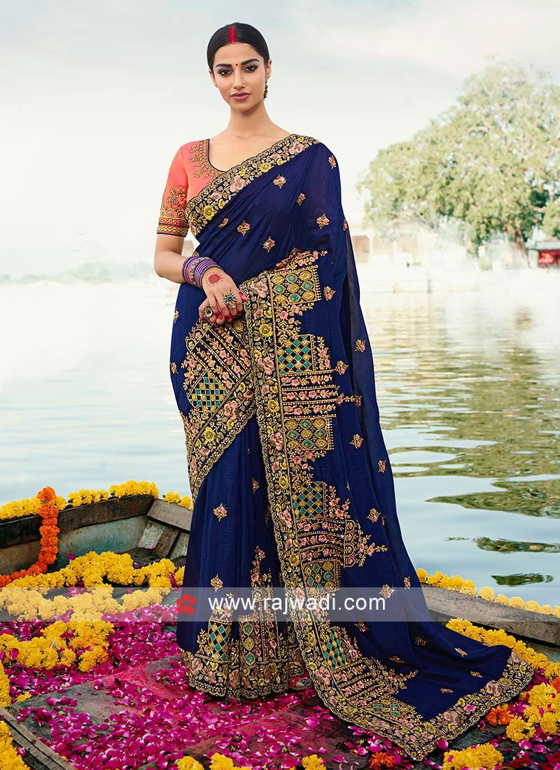 Dark blue art silk saree paired with contrast blouse.