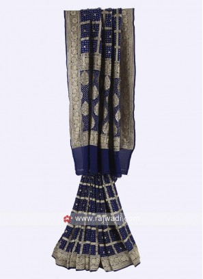 Dark blue chiffion saree with matching blouse.